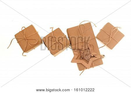gift boxes of kraft paper tied with a rope on a white background.
