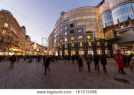 VIENNA AUSTRIA - 2ND DECEMBER 2016: A view along Graben and Stephansplatz at night during the Christmas season. People decorations and buildings can be seen.