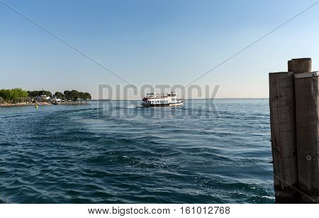 PADUA, ITALY - MAY 3, 2016: Ferry boat on Lake Garda. Garda Lake is one of the most frequented tourist regions of Italy.