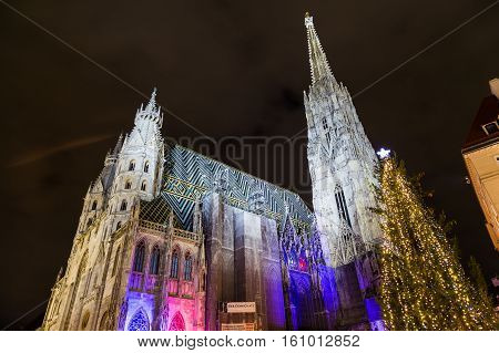 VIENNA AUSTRIA - 2ND DECEMBER 2016: A low angle view towards Stephandsom in central Vienna during the Christmas season at night