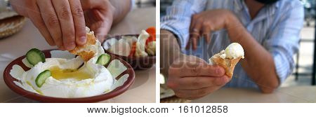 A man dipping pita bread in labneh and offering it.