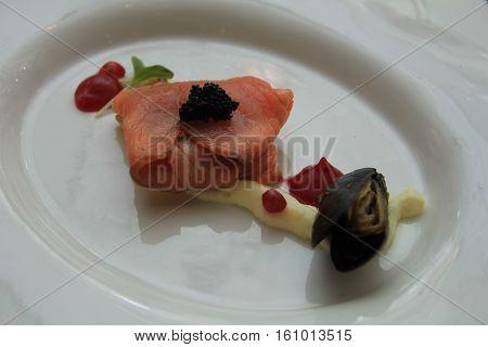 A starter with smoked salmon and caviar