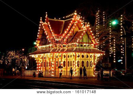 Hua Hin Thailand - December 31 2009: The magical Royal Waiting Room with its vibrant night time illuminations at the Hua Hin Railway Station *