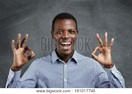 Business, Carrier And Success. Young Dark-skinned Businessman Having Happy Look, Smiling, Keeping Hi