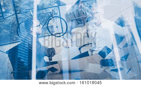Double exposure concept.Business partnership handshake.Photo two bearded businessmans handshaking process.Successful deal after great meeting in modern office.Horizontal, blurred background