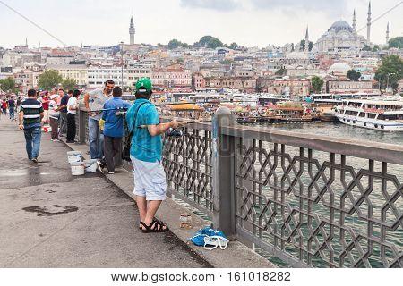 Fishermen On The Bridge In Istanbul, Turkey