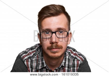Hansome american guy portrait in glasses with peaceful emotion on the face. Beautiful man look to the camera.