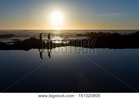 Hiking At Sunset On The Coast