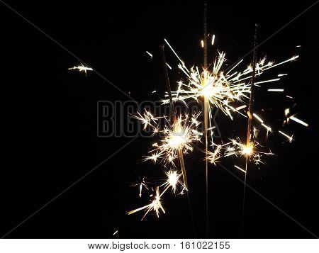 Christmas sparklers in the dark background for xmas new year