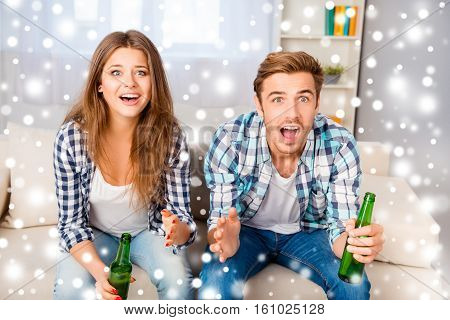 Young Excited Family Watching Football With Beer On Xmas Holidays