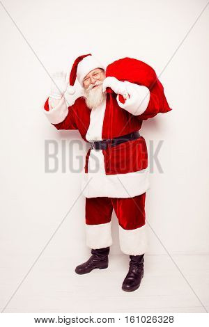 Happy Santa Claus Carrying Huge Bag With Xmas Presents