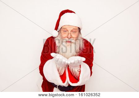 Portrait Of Old Santa Claus Sending Air Kiss On White Background