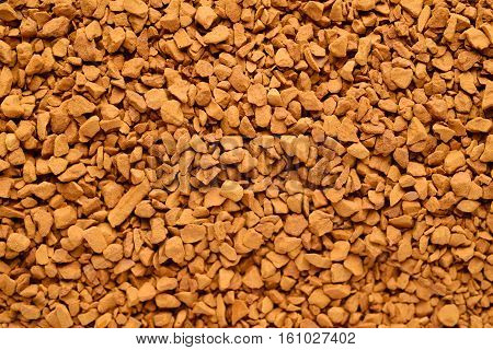 Granules of instant coffee drink background texture