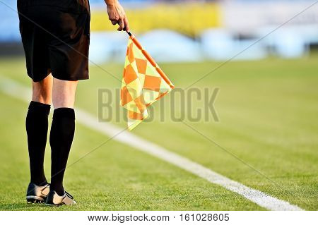 Assistant referee moving along the sideline during a soccer match