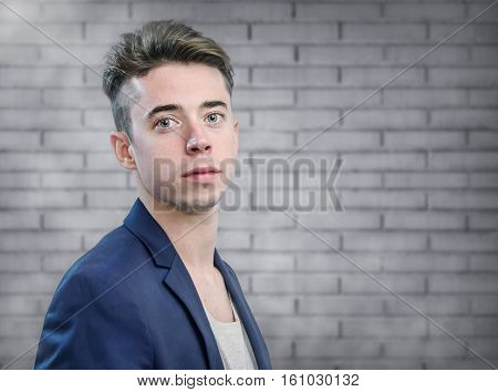 Handsome Young Man Portrait Over Neutral Wall Background