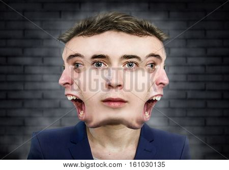 Multiple face man weird portrait over wall background