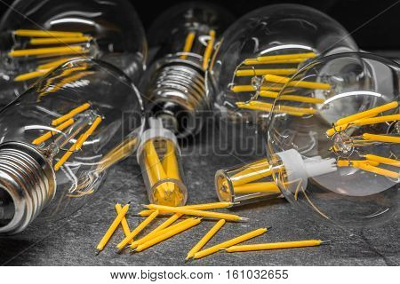 spare LED filaments and LED light filament bulbs produces light that is shaped to look like the filament of an incandescent light bulb