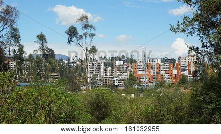 Quito, Pichincha / Ecuador - December 10 2016: View of the northern part of the city of Quito from the Metropolitan Park Guanguiltagua