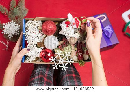Female Holding An Opened Christmas  Decoration Box