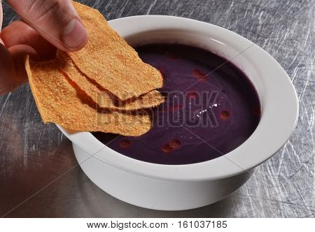 Beetroot soup gourmet style and chef hands.