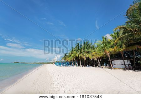 mesmerizing, stunning beautiful view of white sand inviting beach with people in background, Cuban Cayo Coco island
