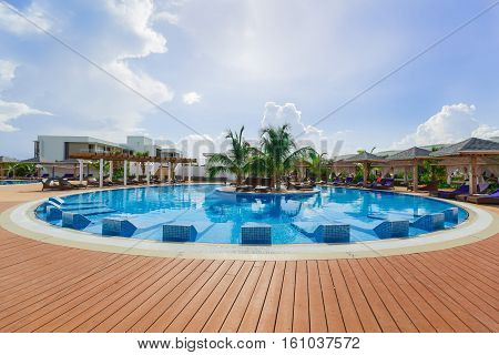 Cayo Guillermo island, Cuba, June 28, 2016, amazing gorgeous view of a round swimming pool at Iberostar Playa Pilar resort with people relaxing and enjoying their leisure time on sunny beautiful day