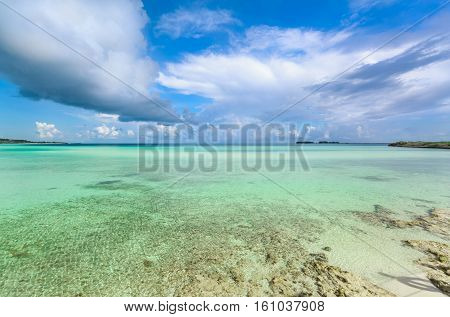 Nice beautiful inviting view of turquoise tranquil ocean and blue sky background at Cayo Guillermo island, Cuba on sunny gorgeous day