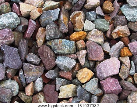 A closeup of a bed of multi-colored rocks.