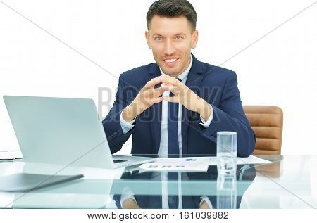 on a white background accountant sitting in front of an open laptop. on the table laid out financial charts. Photo has free space for your text