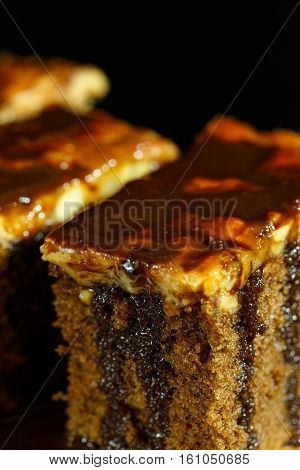 Cake toffee with chocolate on top and black background
