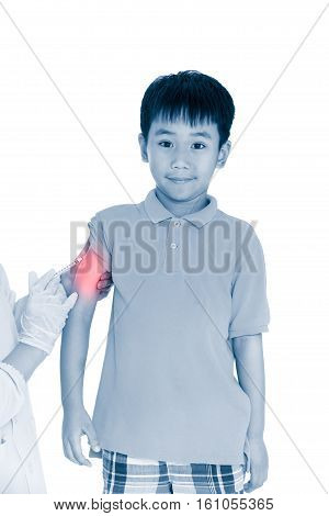 Doctor vaccinating boy's arm. Happy asian illness boy with vaccine syringe. Isolated on white background.  Human health care and medical concept. Photo with color increase blue skin and red spot.
