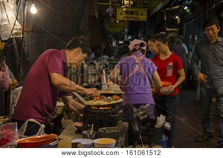 Bangkok Thailand - 31 January 2015 : chinese chef cooking a chinese food at bangkok chinatown on Yaowarat Road many chinese food vendor around bangkok chinatown.