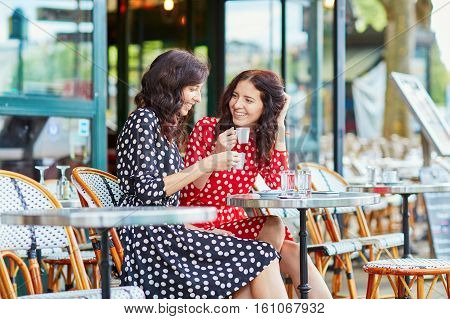 Beautiful Twin Sisters Drinking Coffee In Paris