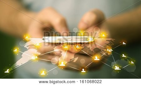 Smart man holding telephone with world social media network connection