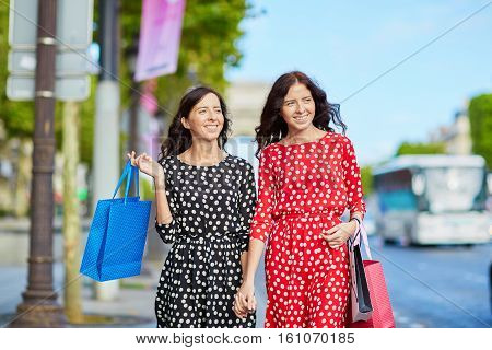 Beautiful Twin Sisters Shopping In Paris
