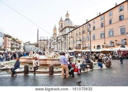 Piazza Navona With People And Fountain Of Neptune