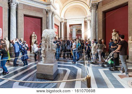 Tourists Near Ancient The Belvedere Torso Statue