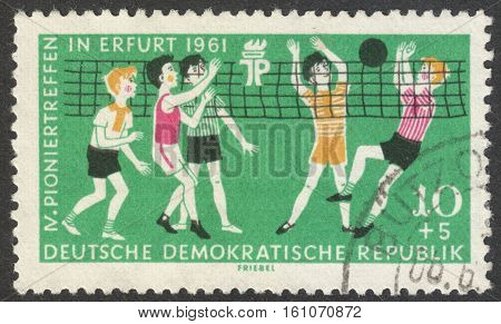 MOSCOW RUSSIA - CIRCA NOVEMBER 2016: a post stamp printed in the DDR shows kids the series