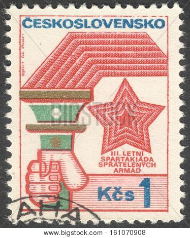 MOSCOW RUSSIA - CIRCA NOVEMBER 2016: a post stamp printed in CZECHOSLOVAKIA dedicated to the 3rd summer army Spartakiad of socialist countries the series