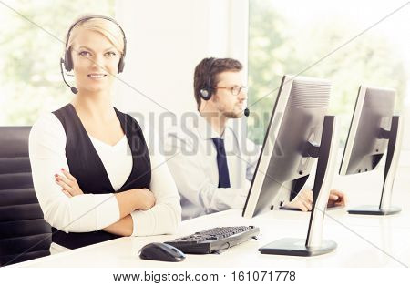 People working in a call center office. Man and woman at work. Business support concept.