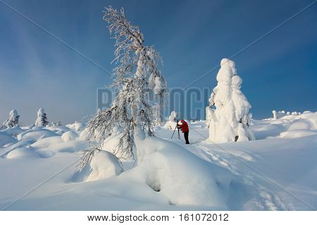 Extreme cold winter landscape with one photographer man - beautiful northern nature
