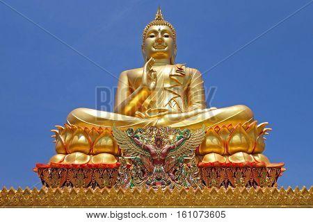 a golden big buddha thailand style statue