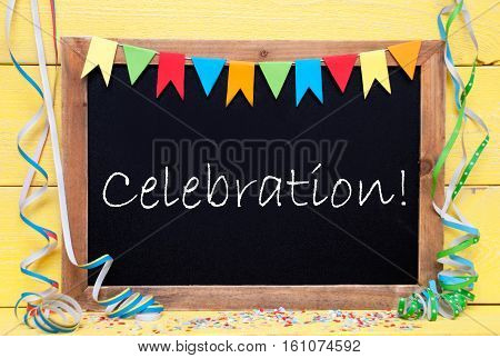 Blackboard With English Text Celebration. Party Decoration Like Streamer And Confetti. Yellow Wooden Background. Greeting Card For Celebrations