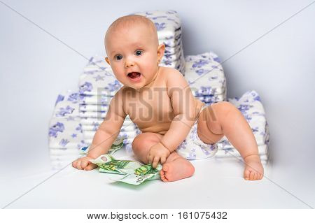 Cute Baby With Money Isolated On Blurry Diapers Background