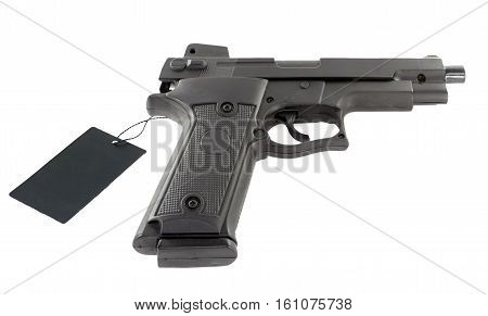 Handgun with price tag on a white background