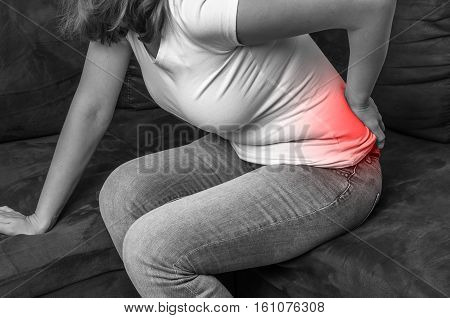 Woman With Back Pain - Black And White Photo