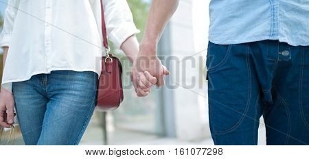 Couple walking hands in hands