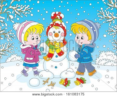 Small children making a funny Christmas snowman