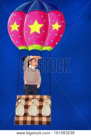 child flying a hot air big balloon