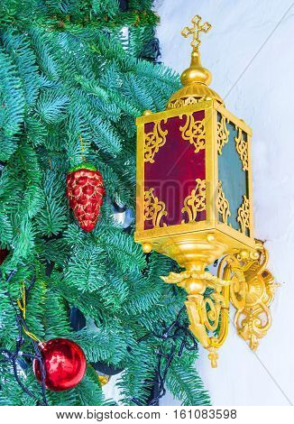 Christmas arrangement of fir branches, Christmas tree decorations and Christmas lantern